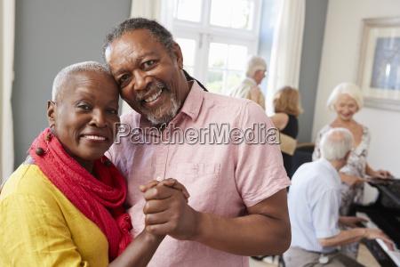 portrait of senior couple enjoying dancing