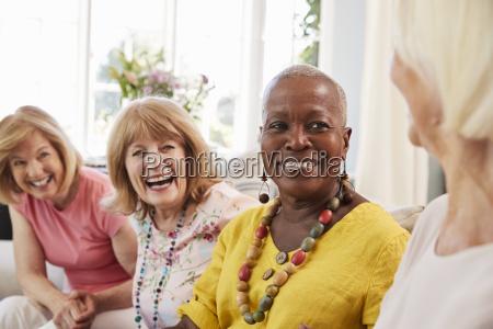group of senior female friends relaxing