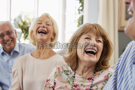 group of senior friends relaxing on
