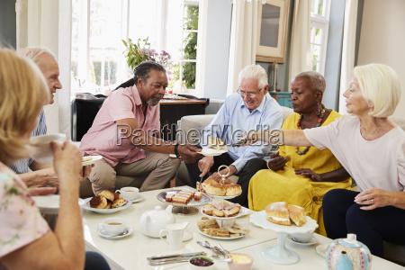 group of senior friends enjoying afternoon