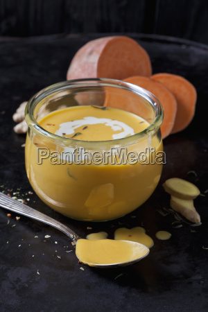 glass of sweet potato soup with