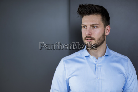 bearded businessman looking away