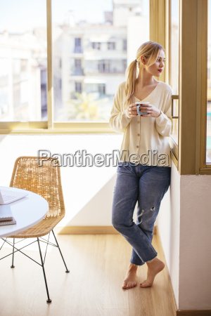 blonde woman with cup of coffee