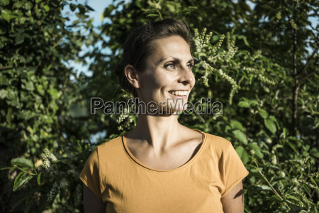 portrait of smiling woman in nature