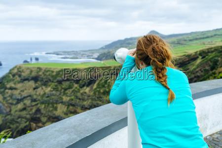 azores sao miguel woman looking through