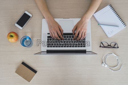 top view of woman using laptop