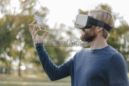 man in autumnal park wearing virtual