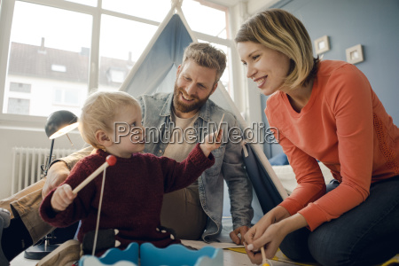 happy family playing with their son