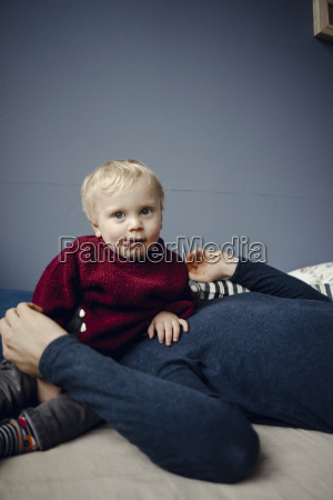 father and son resting on couch