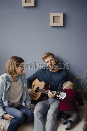 happy family playing music with their