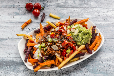 vegetable fries with vegetarian bolognese guacamole