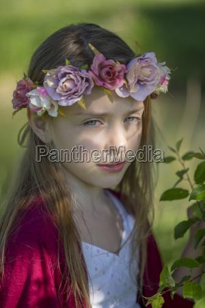 portrait of daydreaming little girl wearing