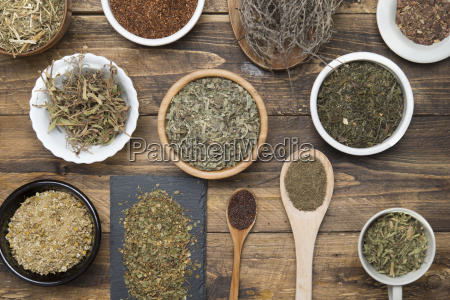 various herbal infusions on wood chamimile