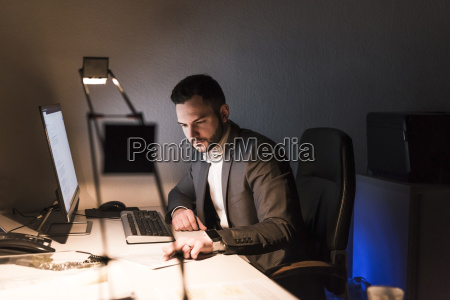 businessman working on desk in office