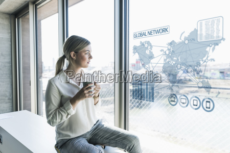 young businesswoman looking at virtual world