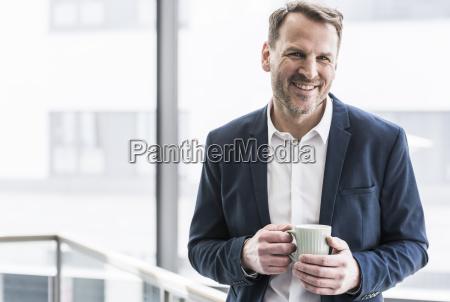 portrait of smiling businessman having a