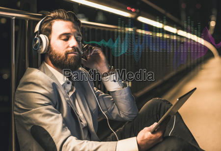 young man with tablet and headphones
