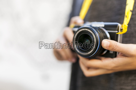 close up of woman with camera