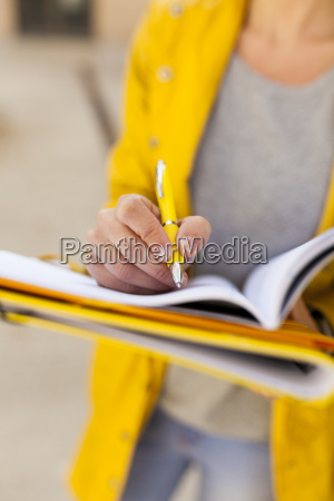close up of woman taking notes