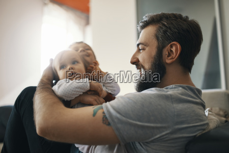 happy father with baby girl and