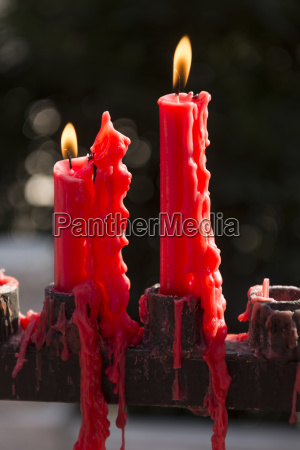candles at buddhist temple