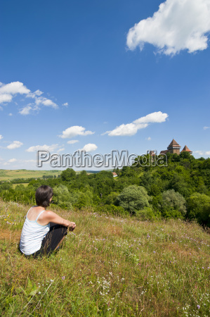 woman looking at the fortified saxonian