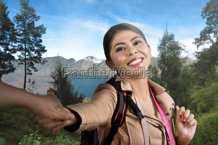 young asian traveler woman holding husband