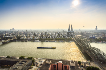 koln cityscape with cathedral and steel