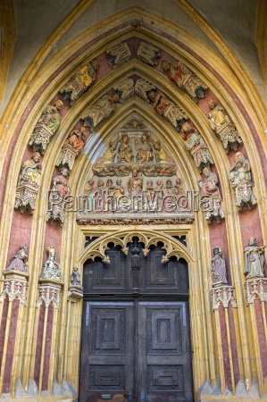 tympanum and archivolts with colorfully painted