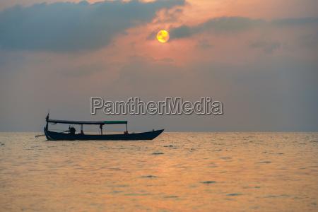 boat at sunrise over the sea