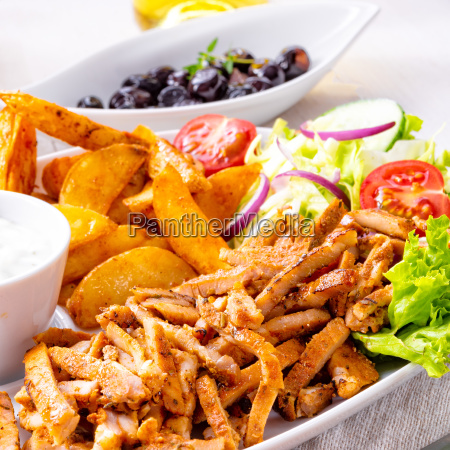 gyros plate with green salad olives