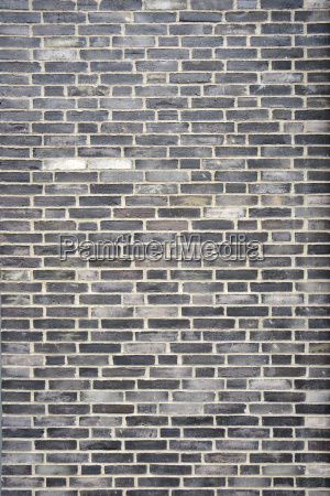 hintergrundbild dunkelgraue backsteinmauer