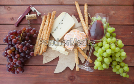cheese plate with colorful grapes
