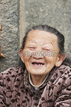 an old hakka minoritys woman laughing