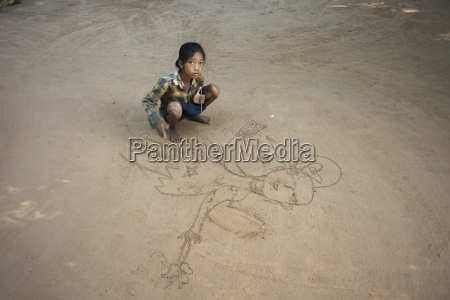 a young girl drawing on the