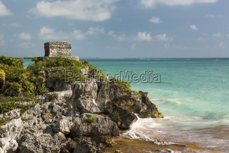 ancient mayan temple on rock cliff