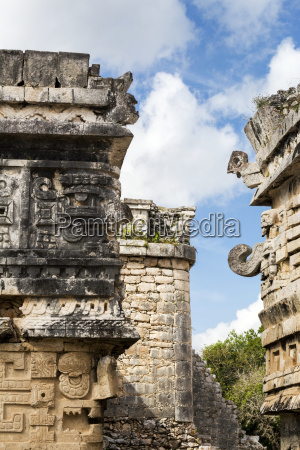 detailed stone carvings on ancient mayan