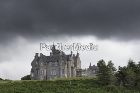 large house under storm clouds isle