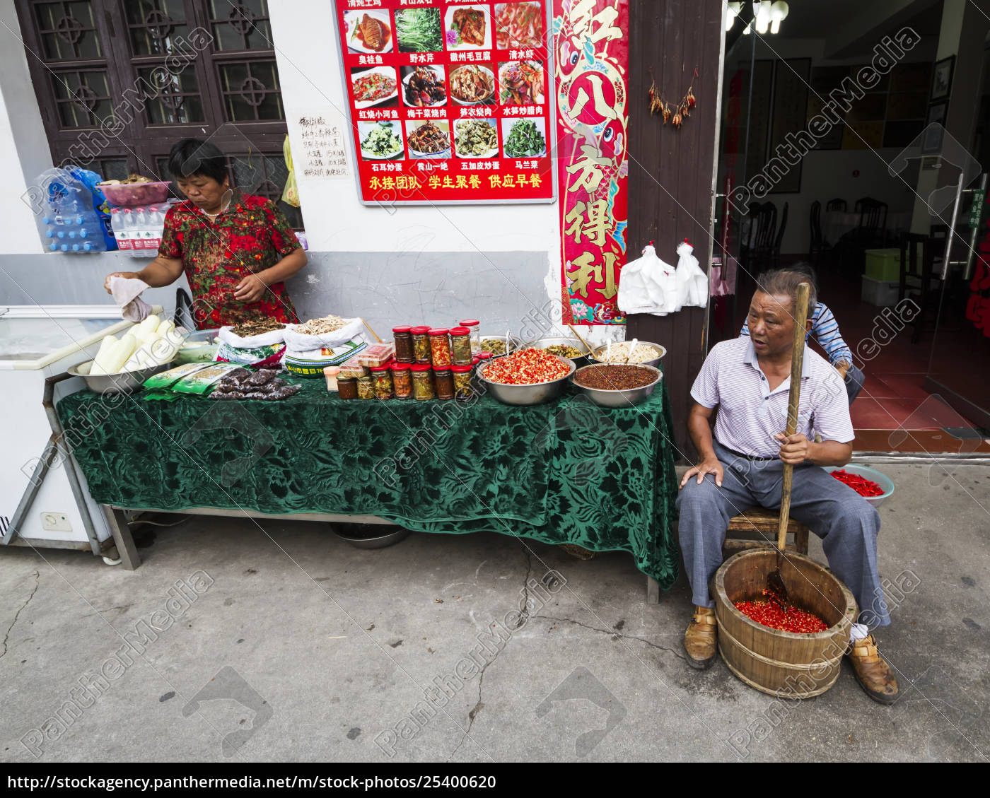 man, crushing, hot, peppers, hongcun, anhui, china - 25400620
