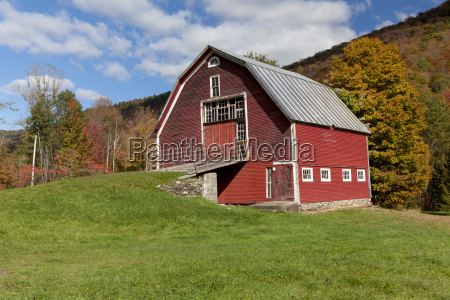 red barn with blue sky along