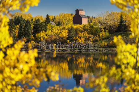 wooden grain elevator surrounded by colourful