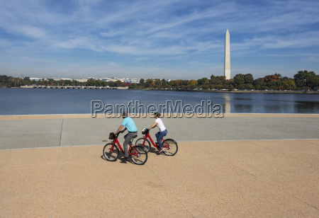 visitors riding bikeshare bikes along tidal