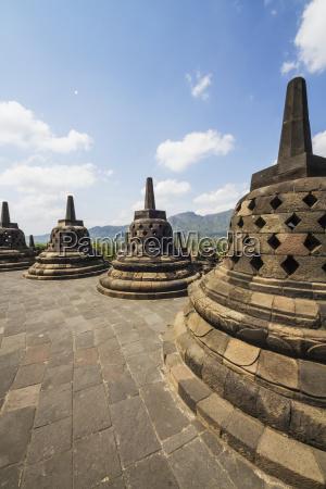 latticed stone stupas containing buddha statues