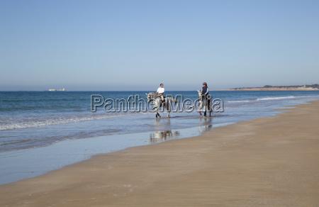 horseback riding on the beach at
