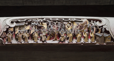 wooden beam decorated with carvings of
