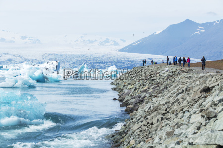 a group of tourists stands at