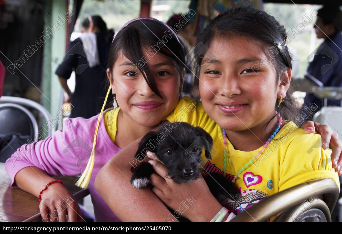 girls, holding, a, puppy, cuenca, azuay, ecuador - 25405070