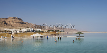 tourists swimming in the dead sea