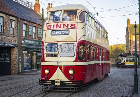 tram traveling along high street in