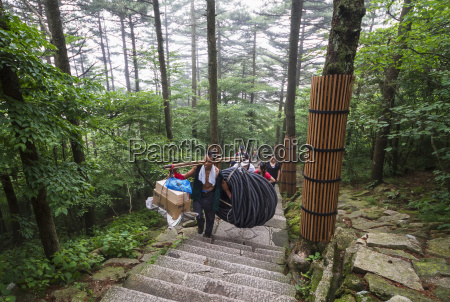 porter carrying items mount huangshan anhui